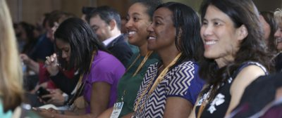convention photography Attendees in Audience at Convention laughing at a speaker telling joke.